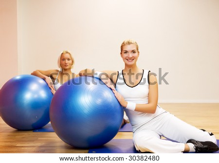 Group of people doing fitness exercise with a ball - stock photo