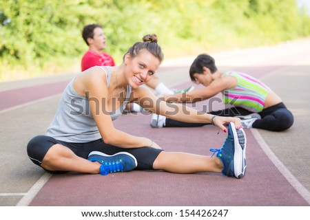 Group of People doing Stretching Exercises