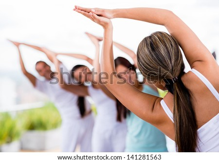 Group of people doing yoga and stretching