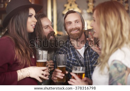 Group of people drinking beer in the pub