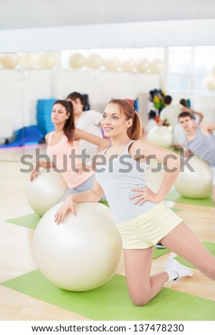 Group of people engaged on fitballs - stock photo