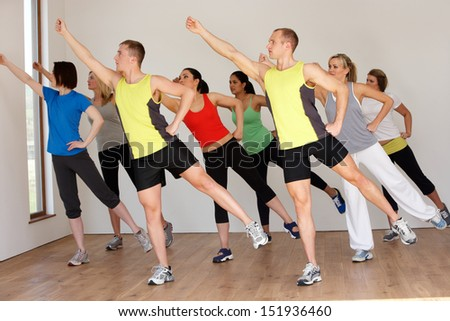 Group Of People Exercising In Dance Studio - stock photo