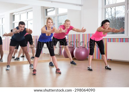 Group of people exercising in pilates room