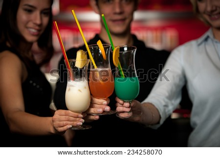 group of people gathering in cocktail bar and having fun - stock photo