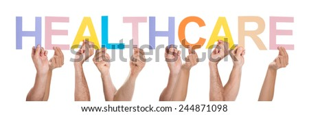 Group Of People Hands Holding Multicolored Healthcare Text Over White Background - stock photo