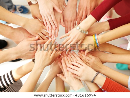 Group of people hands together - stock photo