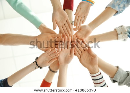 Group of people hands together, looking up view - stock photo