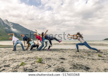 Group of people having fun on the beach of Norway