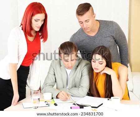 Group of people having meeting in office