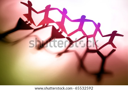 Group of people holding hands together - stock photo