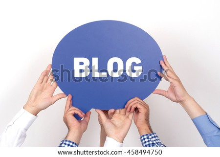 Group of people holding the BLOG written speech bubble