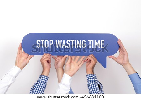 Group of people holding the STOP WASTING TIME written speech bubble - stock photo
