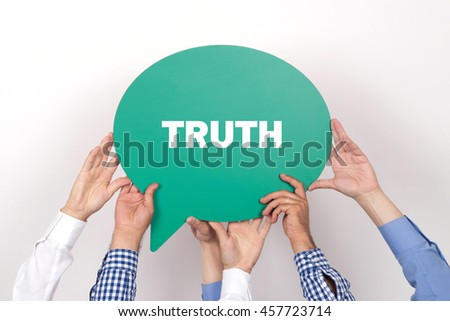 Group of people holding the TRUTH written speech bubble - stock photo