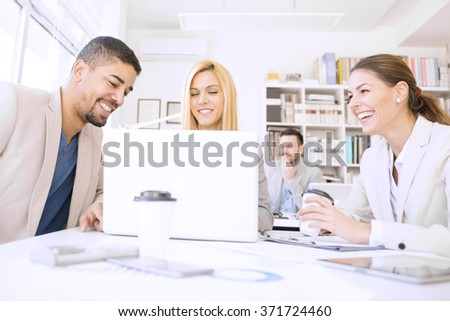 Group of people in a business meeting discussing ideas at the office.They are working on a new project. - stock photo