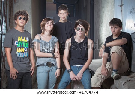 Group of people in an alley - stock photo