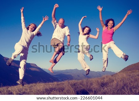 Group of People Jumping Happiness Outdoors Concept - stock photo