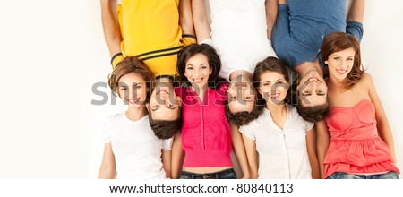 group of people laying down with head on each others shoulders, smiling