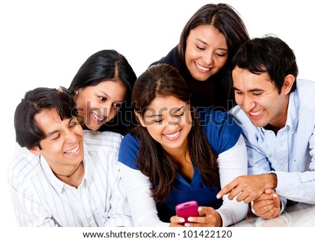 Group of people looking at a cell phone  and smiling - isolated - stock photo