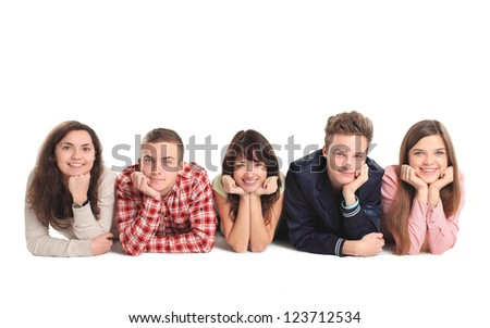 Group of people lying on the floor isolated over a white background - stock photo