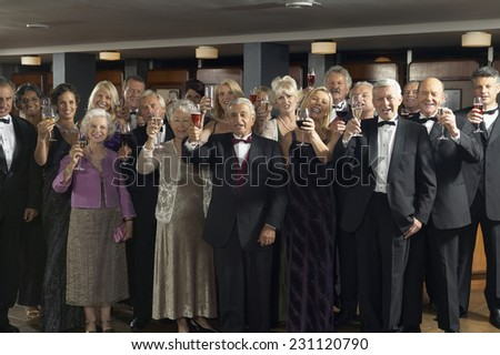 Group of People Making a Toast in Theater Bar - stock photo
