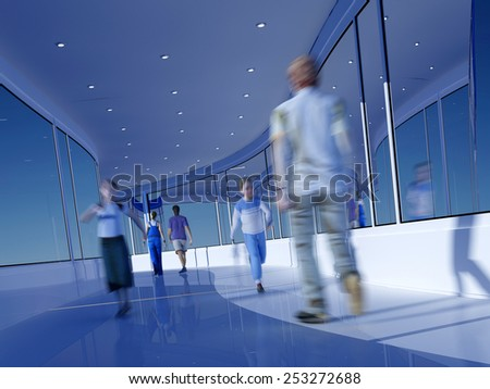 Group of people moving along the glass corridor. - stock photo