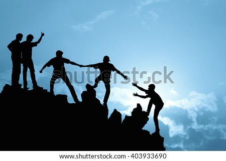 Group of people on peak mountain  climbing helping team work , success concept  - stock photo