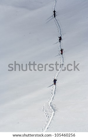 Group of people on snowy path