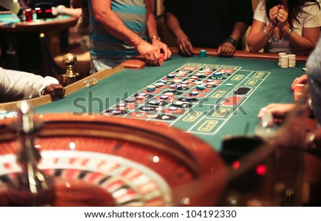 Group of people on the casino roulette playing