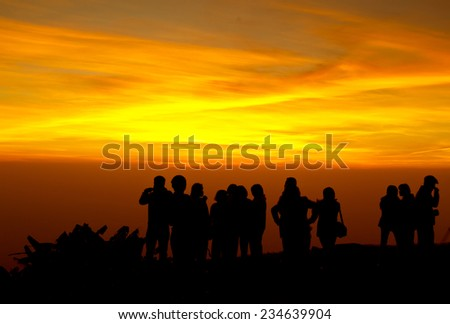 group of people on top of a mountain waiting for take photo with light Twilight.