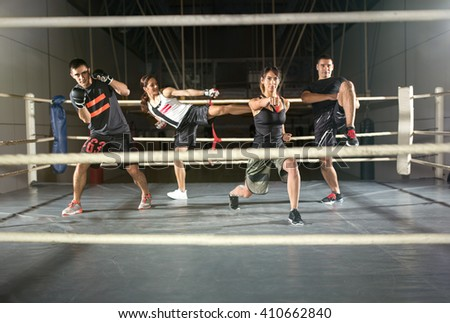 group of people practicing body combat attack in boxing ring - stock photo