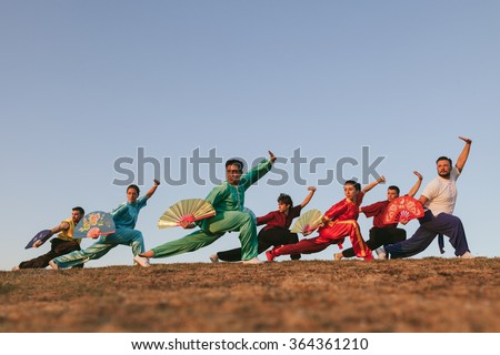Group of People Practising Martial Arts Outdoors - stock photo