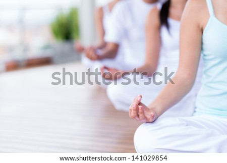 Group of people relaxing and doing yoga - stock photo