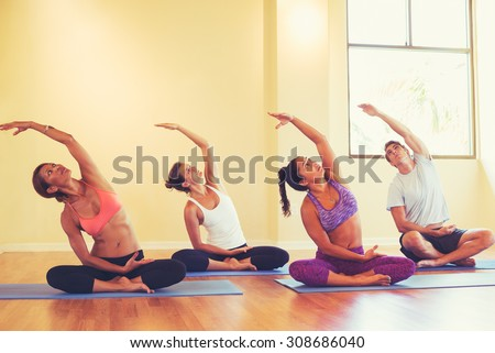 Group of People Relaxing and Doing Yoga. Wellness and Healthy Lifestyle.  - stock photo