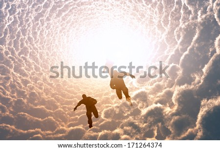 Group of people running in the clouds.