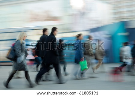 Group of people rushing to work at the morning in intentional motion blur. - stock photo