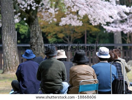 Group of people sitting in garden
