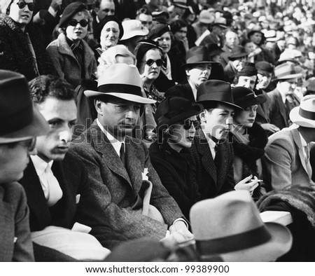 Group of people sitting together - stock photo