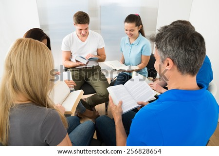 Group Of People Sitting Together Reading Books - stock photo