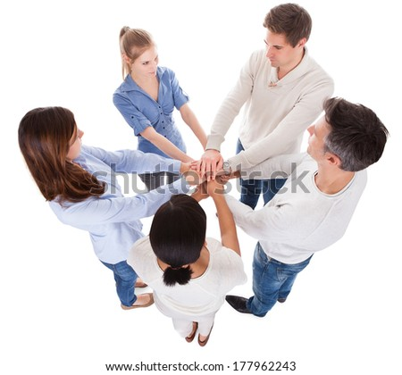 Group Of People Stacking Hand Together Over White Background