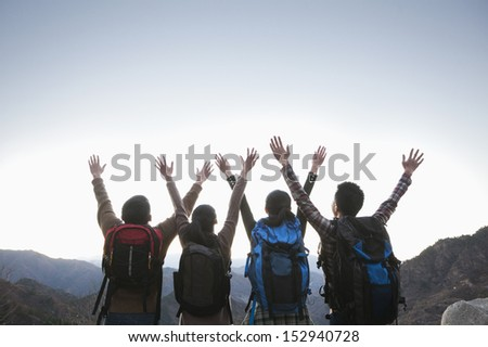 Group of people standing with hands outstretched - stock photo