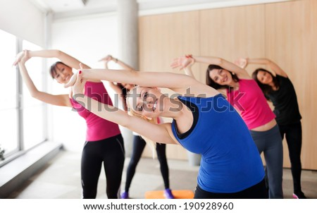 Group of people stretching before yoga class - stock photo