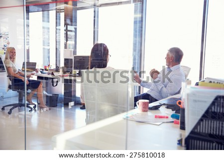 Group of people talking in the office - stock photo