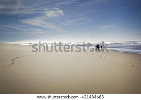Group of people talking on the beach in France