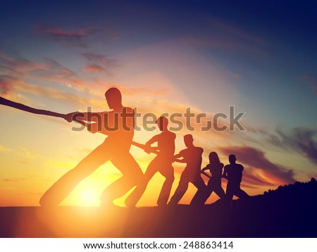 Group of people, team pulling line, playing tug of war. Competition, teamwork, strength. Conceptual - stock photo