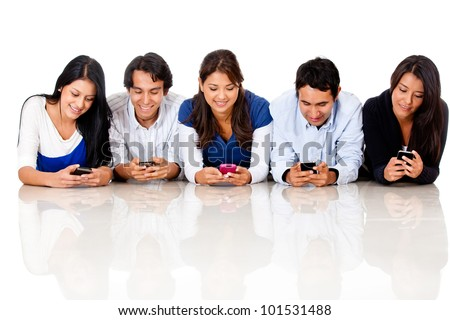 Group of people texting on their cell phones - isolated over a white background - stock photo