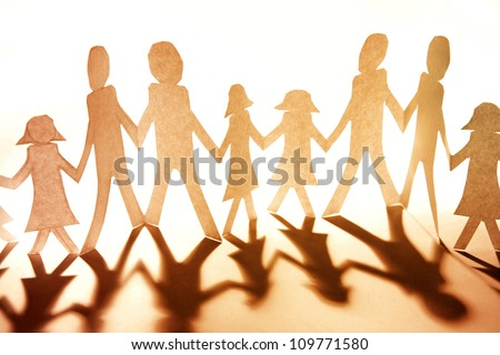 Group of people together holding hands - stock photo