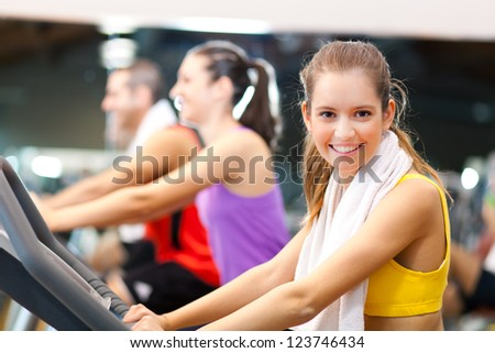 Group of people training in the gym - stock photo