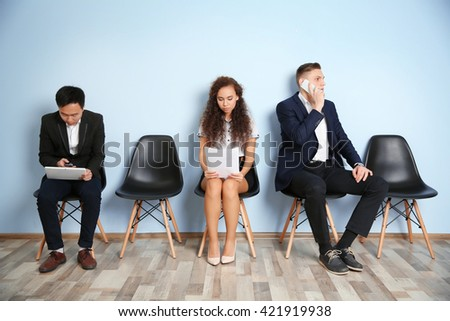 Group of people waiting for interview indoors - stock photo