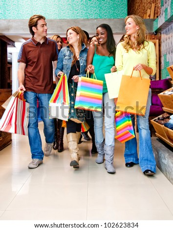Group of people walking at a shopping center - stock photo