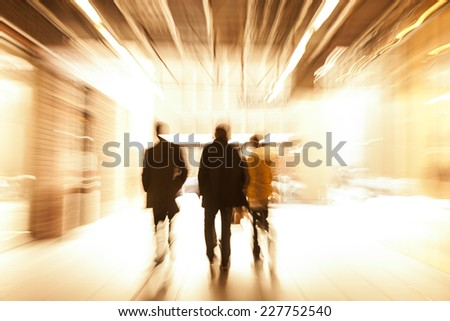 Group of People Walking in Shopping Centre, Motion Blur - stock photo